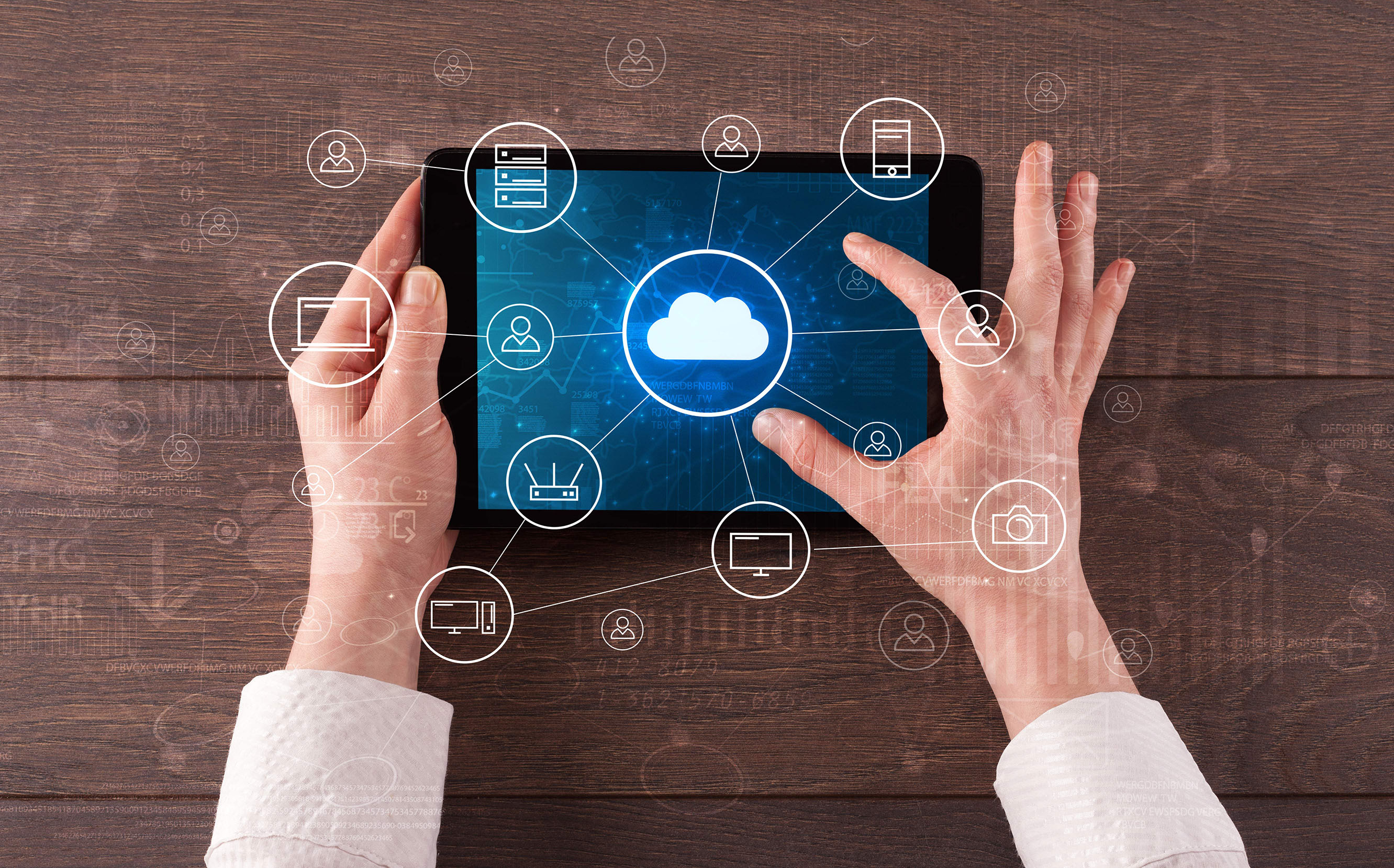 Person using tablet with cloud diagram